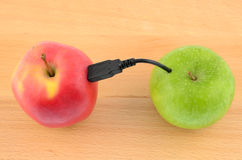 Usb apple. Vitamin download - Usb wired apples Stock Photos