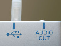 USB and Audio Port. A close-up of the labels of a USB and Audio-out ports of an electronic device (external CD burner stock photos