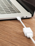 Usb-c cable connect to laptop computer Royalty Free Stock Image