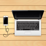 USB cable connect phone and laptop Royalty Free Stock Images