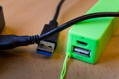 USB 3.0 cable of an external hard drive and power bank royalty free stock photo