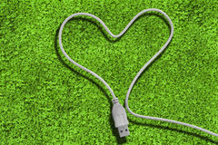 Usb cable forming a heart Royalty Free Stock Photography
