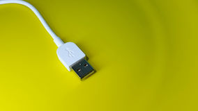 USB cable. Kept on a yellow background Stock Photos