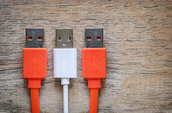 USB cable Plug on wooden background. Stock Photo