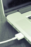USB cable port attach on computer. Notebook Royalty Free Stock Image