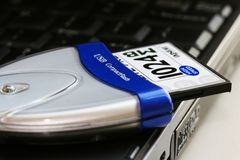 The usb card reader. And 1024 mb  card compactflash Royalty Free Stock Photos