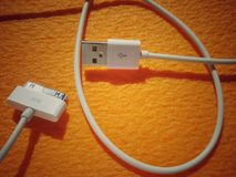 USB charger and connection phone cable Royalty Free Stock Images