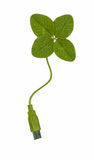 Usb clover. Four-leafed clover with a USB plug at the end of the stalk. Symbol of (green) growth/success coming from using IT Royalty Free Stock Photography