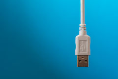 USB connection cable was placed in white on a blue background Stock Photography