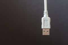 USB connection cable was placed in white on a grey background Stock Photos