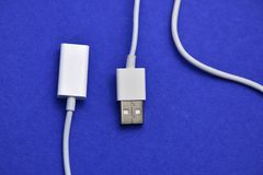 USB connectors. Pair of white usb connectors on violet royalty free stock image