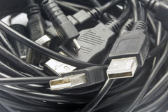 USB Cords. A coil of old random sized usb cords royalty free stock photos