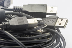 USB Cords. A coil of old random sized usb cords stock photo
