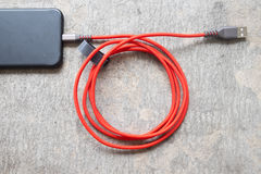 USB data cable connecting on modern gadget. Close up Stock Photography