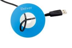 USB de câble dans le disque CD Photographie stock libre de droits
