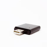 USB Dongle. Small black USB SD card reader isolated against white background Royalty Free Stock Image