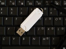 Usb drive on computer keyboard Royalty Free Stock Image