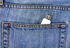 USB Drive in the Pocket. USB Flash Drive in the Jeans Pocket closeup royalty free stock photos