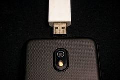 Usb driver and handphone Royalty Free Stock Images