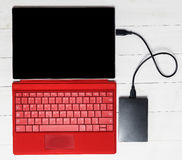 USB External hard disk on Red tablet computer keyboard Royalty Free Stock Photos