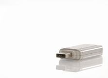 Usb flash drive. Usb flash memory drive with reflection on white background Stock Photo