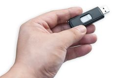 Usb flash drive. In hand on white background Stock Photo