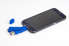 USB Flash Drive for Android Smart Phone. On white stock photo