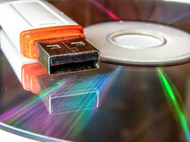 USB flash drive and CD. Stock Photography