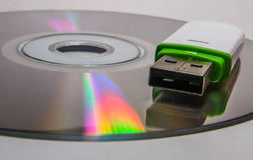 USB flash drive and CD. Royalty Free Stock Image