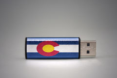 Usb flash drive with the colorado state flag on gray background. Concept royalty free stock photo