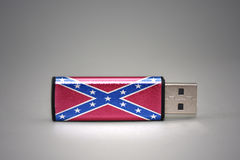 Usb flash drive with the confederate jack flag on gray background. Concept Stock Images