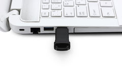 USB Flash drive connecting to laptop Royalty Free Stock Photos