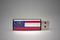Usb flash drive with the georgia state flag on gray background. Royalty Free Stock Image