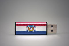 Usb flash drive with the missouri state flag on gray background. Stock Photos