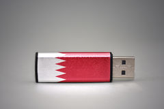 Usb flash drive with the national flag of bahrain on gray background. Royalty Free Stock Image