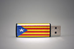 Usb flash drive with the national flag of catalonia on gray background. Royalty Free Stock Image