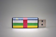 Usb flash drive with the national flag of central african republic on gray background. Royalty Free Stock Image