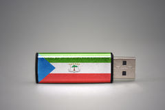 Usb flash drive with the national flag of equatorial guinea on gray background. Royalty Free Stock Image