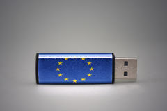 Usb flash drive with the national flag of european union on gray background. Royalty Free Stock Photography