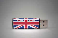 Usb flash drive with the national flag of great britain on gray background. Concept Stock Images