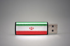 Usb flash drive with the national flag of iran on gray background. Stock Photography