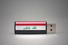 Usb flash drive with the national flag of iraq on gray background. Stock Photography