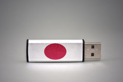 Usb flash drive with the national flag of japan on gray background. Stock Photography