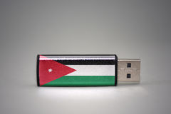 Usb flash drive with the national flag of jordan on gray background. Stock Photos