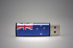 Usb flash drive with the national flag of new zealand on gray background. Stock Images