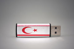 Usb flash drive with the national flag of northern cyprus on gray background. Stock Photo