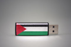 Usb flash drive with the national flag of palestine on gray background. Royalty Free Stock Photos