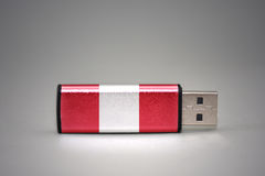 Usb flash drive with the national flag of peru on gray background. stock photography
