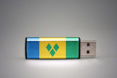 Usb flash drive with the national flag of saint vincent and the grenadines on gray background. Concept Royalty Free Stock Photo