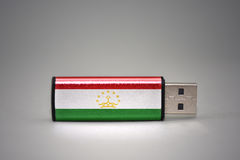 Usb flash drive with the national flag of tajikistan on gray background. Stock Photography